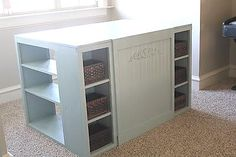 This site even has plans.  This could be my cutting table.  I like the storage for extra supplies as well