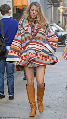 Blake Lively covered up her baby bump with an ethnic print poncho-style jacket as she engaged in some retail therapy at Giggle baby boutique in NYC http://dailym.ai/1vOLBHr
