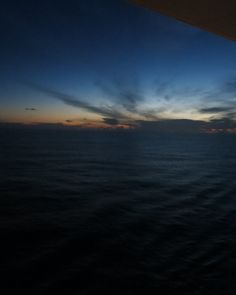 the breaking of dawn over the Caribbean on my balcony on the allure