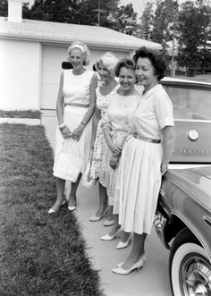 Astronaut wives Jo Schirra, Rene Carpenter, Betty Grissom, and Marge Slayton pose for the press outside the Grissom house following one of the Liberty Bell 7 scrubbed launches, July 1961