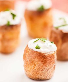 Sour Cream and Chive Stuffed Potato Bites: Bite-sized baby potatoes baked and filled with a simple mixture of sour cream and fresh chives make an easy, affordable appetizer for a crowd.