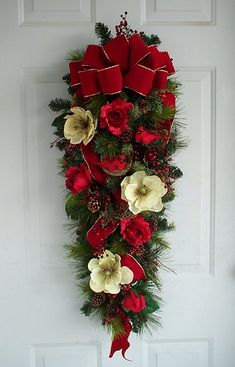 Cardinal Holiday Christmas Door Swag - A mixed pine base covered with red berries, pine cones, pretty red roses and magnolias accented with cardinals perched in their nest.