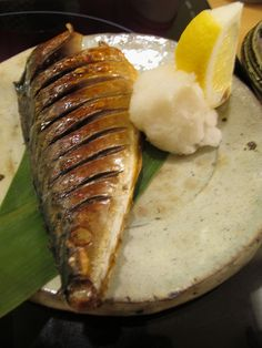 Grilled Japanese Saba Fish. Squeeze the Fresh Lemon