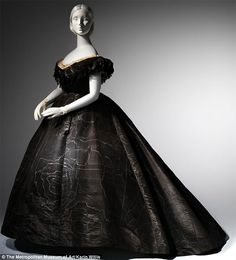 Death Becomes Her: A Century of Mourning Attire Evening Dress, ca.1861 Black moiré silk, black jet, black lace. Lent by Roy Langford. Photo: © The Metropolitan Museum of Art, by Karin Willis