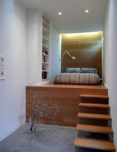 Floating stairs lead to the loft bed