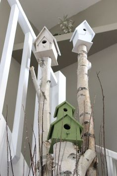 I like this idea for outside. old dead tree, cut off and secure bird house on top of.