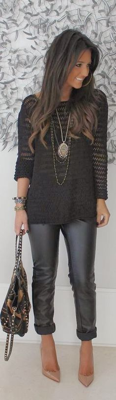 Gorgeous black outfit with handbag, leathear jeans and pendant...plus hair color!