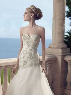 Strapless sweetheart gown; with a bodice of beadwork and embroidery are accented with an assortment of rhinestones and pearls sewn on tulle over Sheer Organza. ...