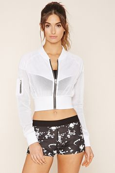 A semi-sheer mesh cropped jacket featuring a zipper front, long raglan sleeves, a zipper key pocket, and a ribbed knit trim.