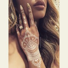 SPECIAL EDITION: • ✨NEW WHITE HENNA TATTOOS✨ Hand-drawn and designed personally by @dressyourface, and created into easy-to-use temporary tattoo sheets by @goldnineink  ❤️ #tamannahennatattoos #whitehenna #specialedition #dressyourface