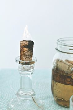 Soak natural corks in acetone alcohol for a week to turn them into candles. Be careful lighting them—we recommend using them for outdoor use only.