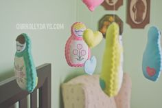 stitched Matryoshka doll mobile in vintage nursery