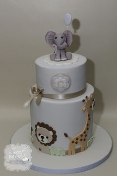 Animal Theme Boy Baby Shower cake - Cute baby shower cake for a soon mommy to be of a baby boy. Bottom tier is my first double barrel cake. Design inspired by a cake by Frisoni Alessandra studio cake. Safari Baby Shower Cake, Baby Shower Cakes For Boys, Baby Boy Cakes, Baby Boy Shower, Cake For Baby, Animal Theme Baby Shower, Baby Showers, Double Barrel Cake, Cake Designs For Boy
