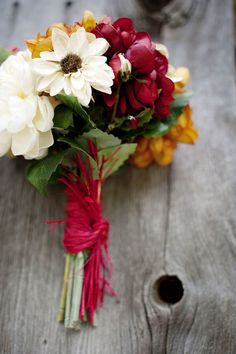 http://www.afloral.com/Silk-Wedding-Flowers/Silk-Bridal-Bouquets/10-5-Sunflower-Rudbeckia-Artichoke-Yellow-and-Cream-Wedding-Bouquet#opi524100606