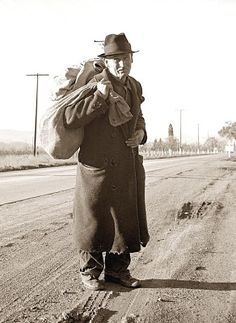 .1938 hobo during the Great Depression. All his earthly possessions fit in a bag.