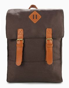 Urban Backpack in brown by Tucked-In. Made of canvas material. Magnetic button. Main compartment and sides compartment.  http://zocko.it/LEQUv