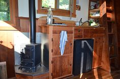 """Wood stove is """"The Hobbit"""", by Salamander Stoves of the UK. Installed in Colin's Coastal Cabin."""