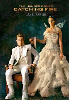 Peeta always looks so young and unprepared for what lies next in that white suit.