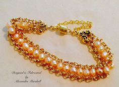 This peach freshwater pearl bracelet with magnetic clasp & safety chain by Alexandra Marshall is hand stitched between the links of 14k gold overlay rolo chains. #B1904. $49. Double click photo to order.
