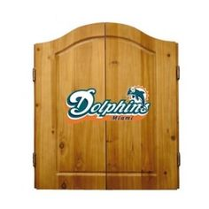 This NFL Miami Dolphins Wooden Dartboard Cabinet Set is made of solid  pine and makes a great gift for the sports fan in your life. This  officially licensed dartboard comes with mounting hardware and six team  logo darts.   Great gift for sports fan Perfect for man cave or garage Made by Imperial International Solid pine wood dartboard cabinet All natural 18-inch bristle dart board Mounting instructions and hardware included Six steel darts with team logo on flights Includes chalk and ...
