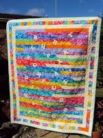 Jellyroll 1600 Quilt.  I like how she cut off the ends and then used as another border.