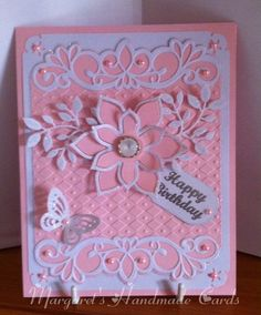 I made this card for a friend's birthday. I used an embossing folder and a few dies glitter and pearls. I heat embossed the tag in silver.