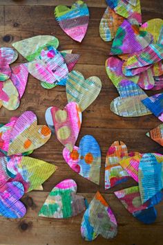 DIY painted newspaper hearts. What a fun and easy project to do with kids! #valentinesday