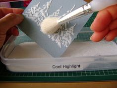 Sparkly glue glitter snow highlights. 1. Craft glue – most regular type of craft glue will work I think, e.g. Aleene's Tacky Glue, Elmer's Glue All, etc.—we do NOT want the thick kind. 2. White acrylic paint (you only need a small amount – approx. 25 drops). Any brand  3. A small empty bottle with a very fine tip (.9 mm aperture). fabric paint section). 4. Glitter—white and/or transparent with highlights--I prefer cool highlights.  5. Card stock—the heavier the better.