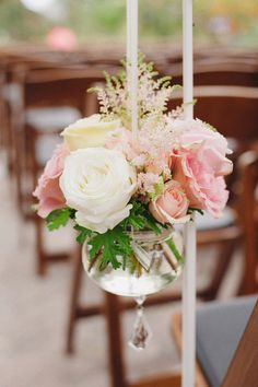 Roses in a suspended glass bowl - clever aisle decor