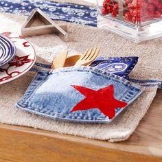 Denim Pocket Place Setting:   For fun Fourth of July place settings, use denim pockets to contain silverware. Cut denim pockets from worn-out jeans and set to the right of each place setting. To emphasize the patriotic scheme, stencil a bright red star on each pocket. Add a bandana napkin and utensils.