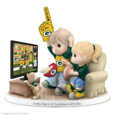A first ever! Limited-edition NFL-licensed Precious Moments figurine celebrates Packers and your sweetheart. Handcrafted in fine bisque porcelain.