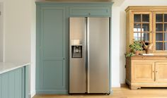 This big Samsung fridge/freezer combination fits perfectly next to our beautiful larder cabinet painted in the new 'Trinity Blue' Shaker colour Wall Cupboards, Kitchen Pantry Cabinets, Kitchen Larder, American Fridge Freezers, American Fridge Freezer Built In, Larder Cupboard, Devol Kitchens, Rustic Country Kitchens, Bright Rooms