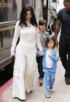 Wow! Kourtney Kardashian looked ready to rave at EDC in her wide-leg cargo khakis while dr...