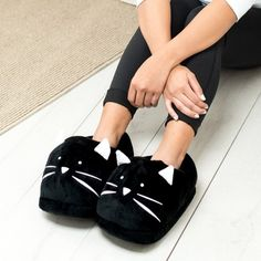And a pair of floofy black cat slippers to seal your commitment to staying in. | 25 Products For A Cozy Valentine's Day At Home