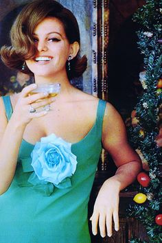 old-timey Champagne glasses rule | Claudia Cardinale celebrating Christmas, 1964