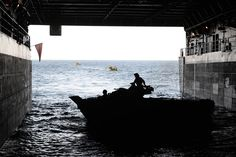 150612-N-ZZ999-634  BALTIC SEA (June 12, 2015) U.S. Marines load an amphibious assault vehicle aboard USS San Antonio LPD-17 during Baltic Operations 2015 (BALTOPS), June 12.  BALTOPS is an annual multinational exercise designed to enhance flexibility and interoperability, as well as demonstrate resolve among allied and partnered forces to defend the Baltic region. Photo by Petty Officer 1st Class Adam C. Stapleton.