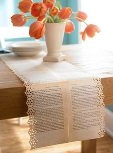 book page table runner with pretty punched edge.