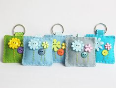 Blue Flower Keychain A cute Flower button keyring. handy to keep your keys safe or to hang off a handbag or childs book bag. These keyrings has been lovingly hand sewn using wool blended felt, embellished with cute round & flower shaped buttons in green, yellow and orange with an