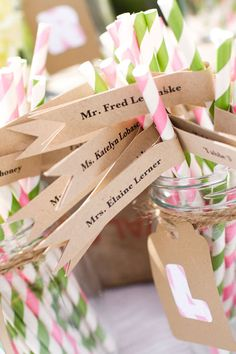 Striped straws with name flags, such a fun and cute way to display escort cards! See more of the darling designs from Four 13 Designs here http://www.weddingchicks.com/vendor-guide/four-13-designs/