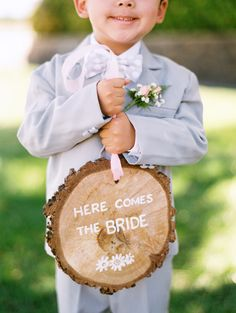 Instead of giving the ring bearer the real rings or a fake substitute, give him a here comes the bride sign. I love this sign on a rustic wood stump. Our will say Justin, Here comes your Bride! Wedding Ceremony Ideas, Wedding Signs, Wedding Bells, Our Wedding, Dream Wedding, Wedding Hacks, Wedding Favors, Camo Wedding Decorations, Wedding Aisles