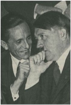 Goebbels flirting with Hitler.