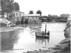 Molino del Marqués visto desde Vistabella y barca existente para cruzar el río Segura
