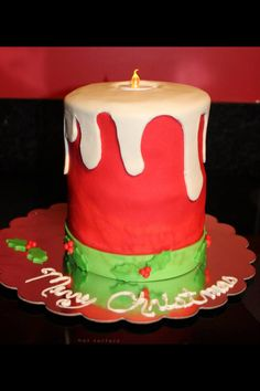 Christmas Candle Cake, filled and covered with buttercream and marshmallow and buttercream fondant with fondant details topped with reusable candle for light created by Danielle McLeod @ Sugared Cakes & Bakes #christmascake #candlecake