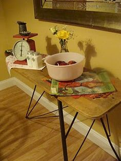 vintage ironing board.. cute if you have the room to set up.. old irons etc.. would be sooo cute here..