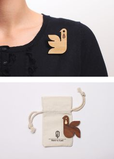 why so sad little birdy? you're so cute! love the idea of laser cut wooden badges as mascots.