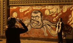 Graffiti portraying the Egyptian president, Mohamed Morsi, during a demonstration outside the presidential palace in Cairo.