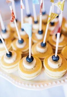 Banana & blueberry topped mini pancake skewers — adorable brunch food to feed a crowd!
