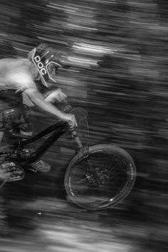 Gray Scale Photo of Person Riding Bike