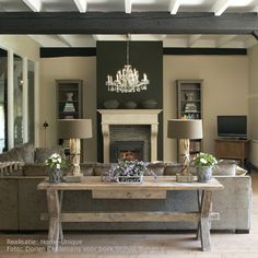 Perfect layout for the den! Contrast of the fireplace wall and beams are fabulous