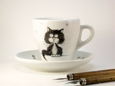 black cat porcelain cup and saucer handpainted by madrab on Etsy, €30.00